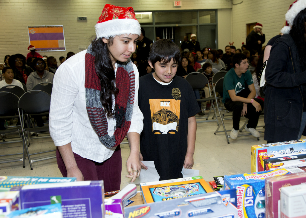 Annual Toy Drive showing child a toy