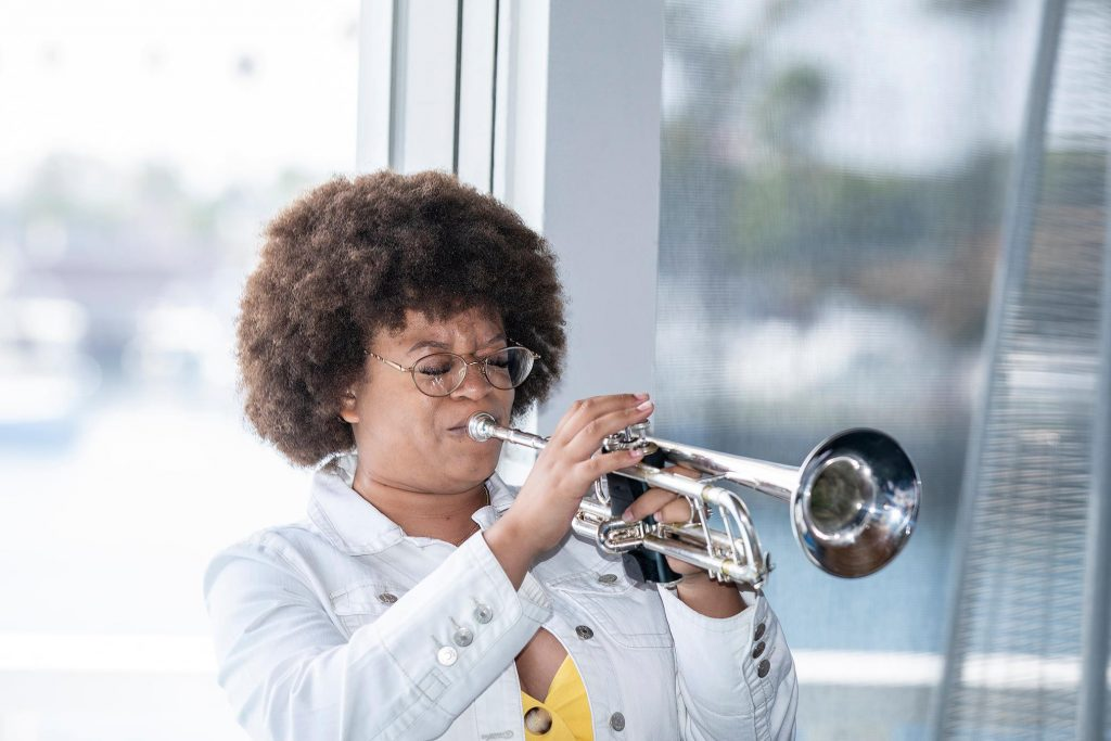 NAACP Scholar and Scholarship recipient provides trumpet solo.