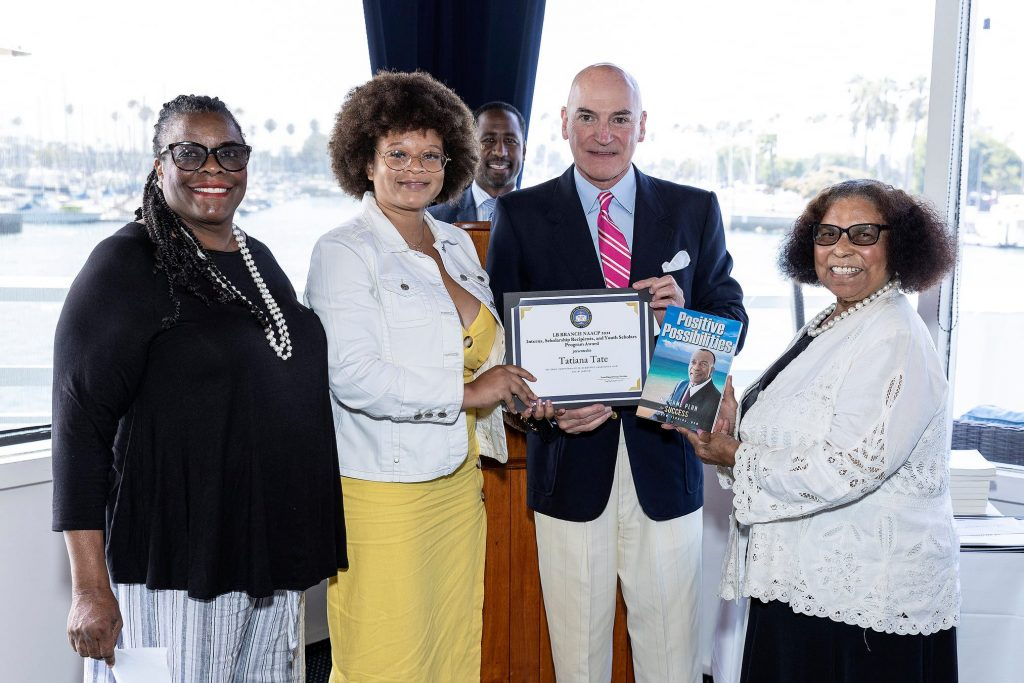 Tatiana receives the LB Branch NAACP 80th Anniversary Scholarship presented by President Rainey, Dr. Robert Nagourney, and Minine Douglas. Each recipient received Positive Possibilities: My Game Plan for Success written by the late Matthew Jenkins, DVM and Roberta Jenkins.